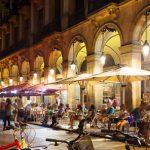 Outdoor restaurants at Placa Reial in summer night. Barcelona, Spain